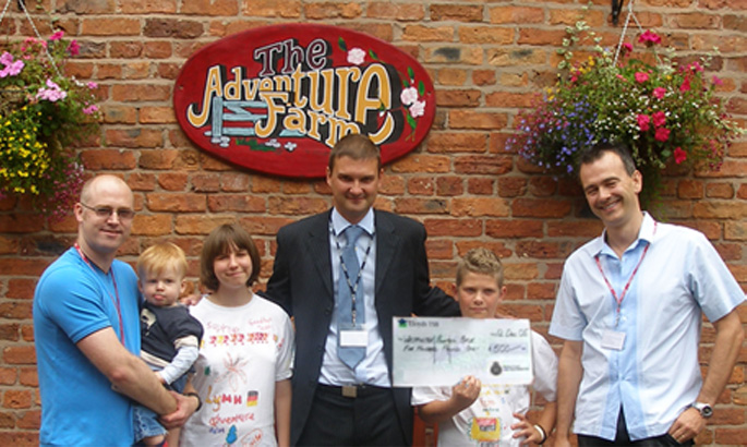 Dave and Rik handing over £500 to the Childrens Adventure Farm